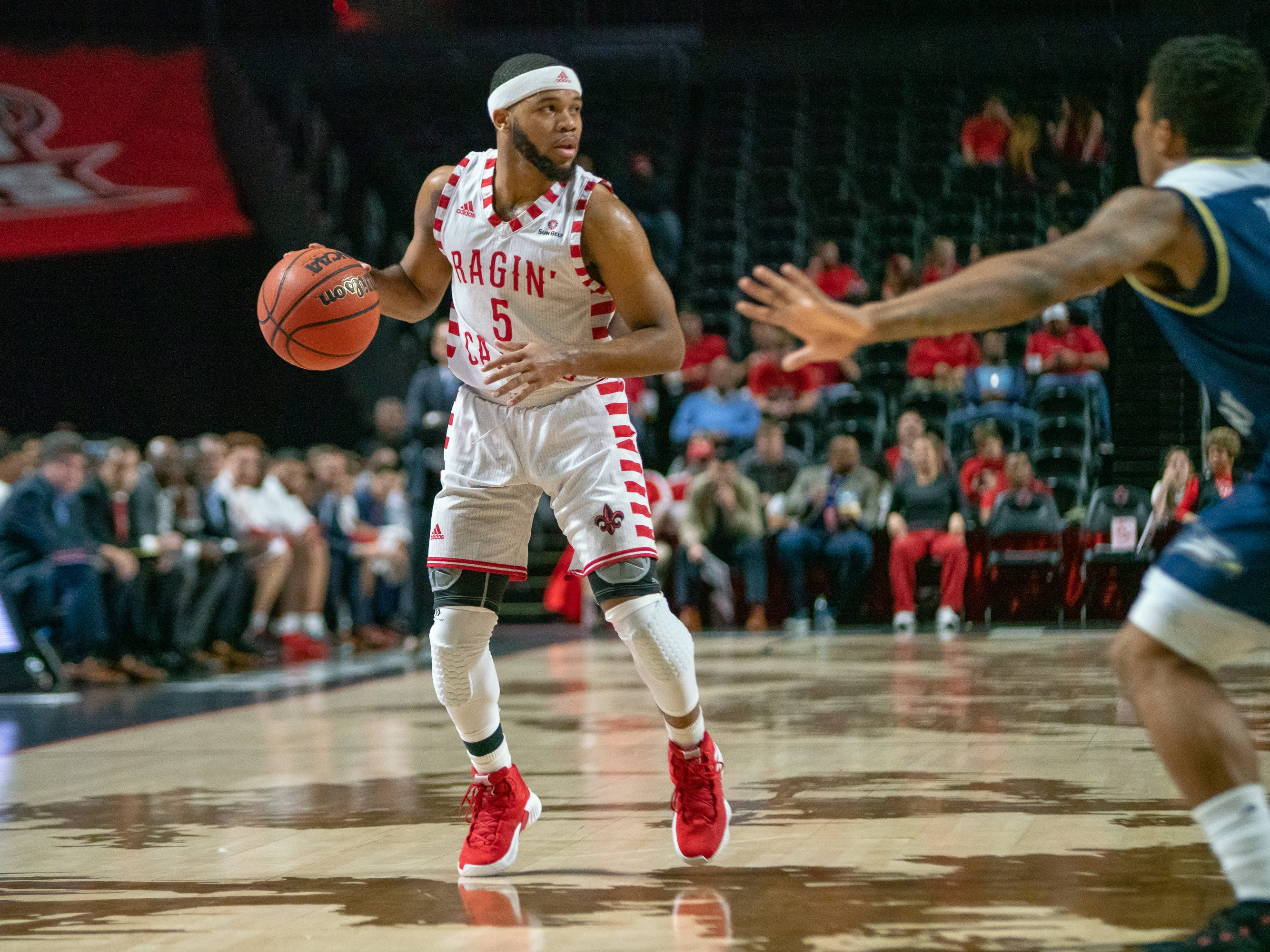UL's Trajan Wesley handles the ball during the play as the Ragin' Cajuns take on the Georgia Southern Eagles at the Cajundome on Feb. 6, 2019.