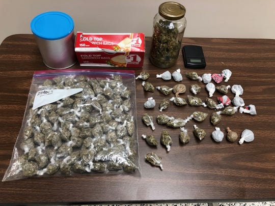 Nearly 100 bags of marijuana with a street value of $2,000 was seized from a vehicle Wednesday.