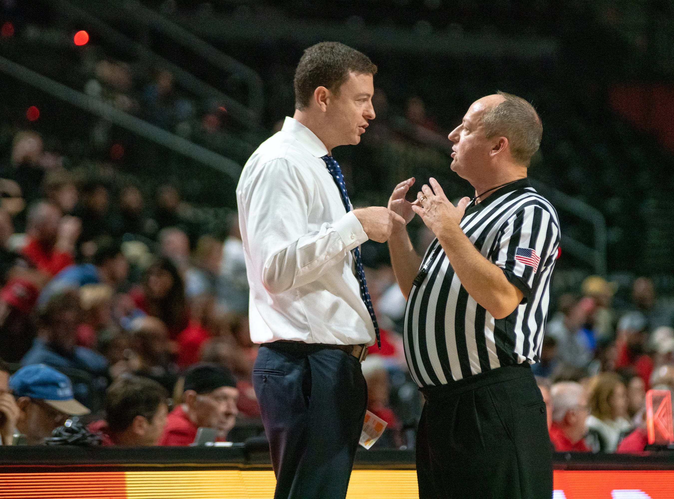 Georgia Southern head basketball coach Mark Byington talks with an official during the game as the Ragin' Cajuns take on the Georgia Southern Eagles at the Cajundome on Feb. 6, 2019.