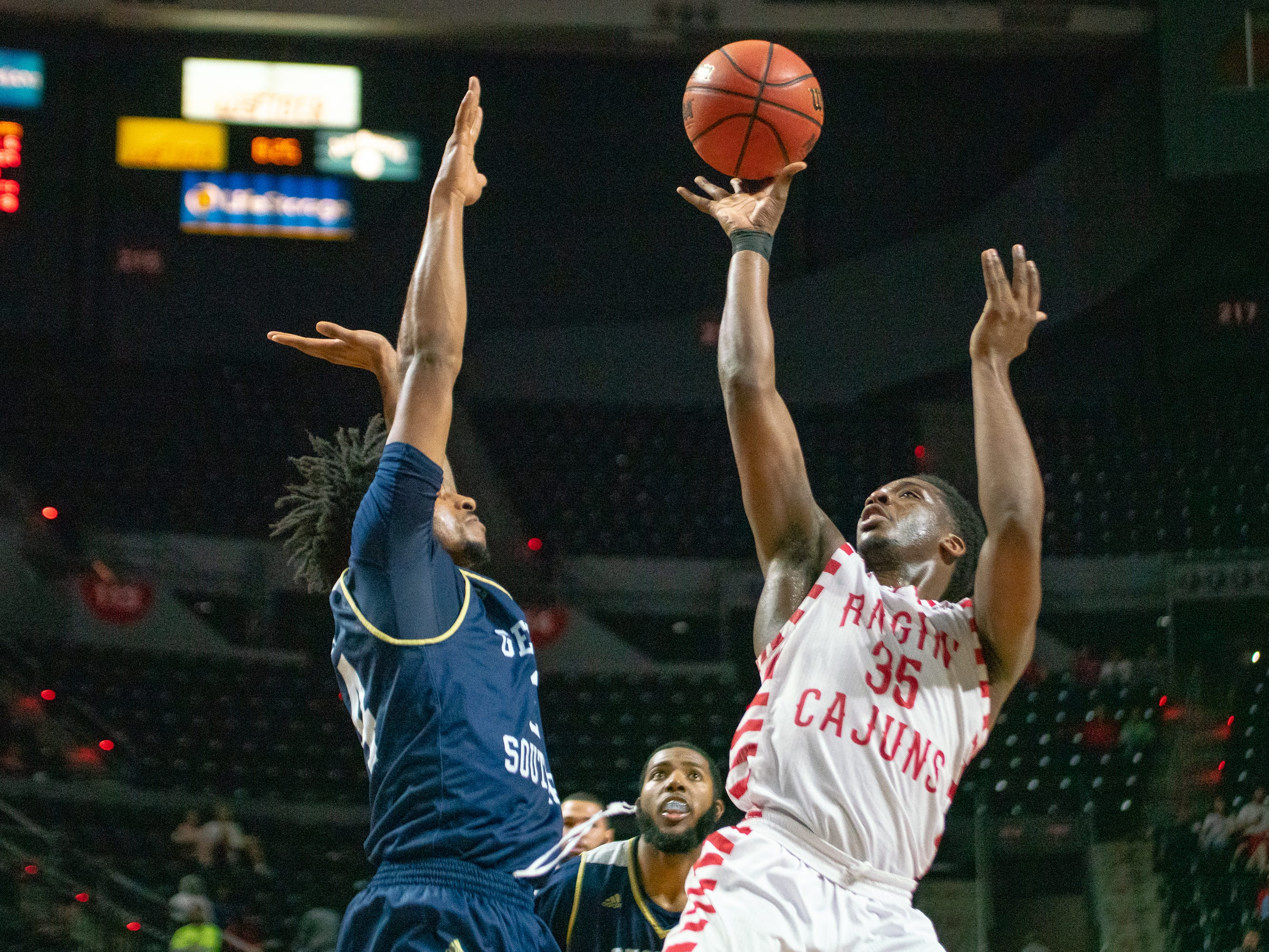 UL's Marcus Stroman shoots the ball over a defender as the Ragin' Cajuns take on the Georgia Southern Eagles at the Cajundome on Feb. 6, 2019.