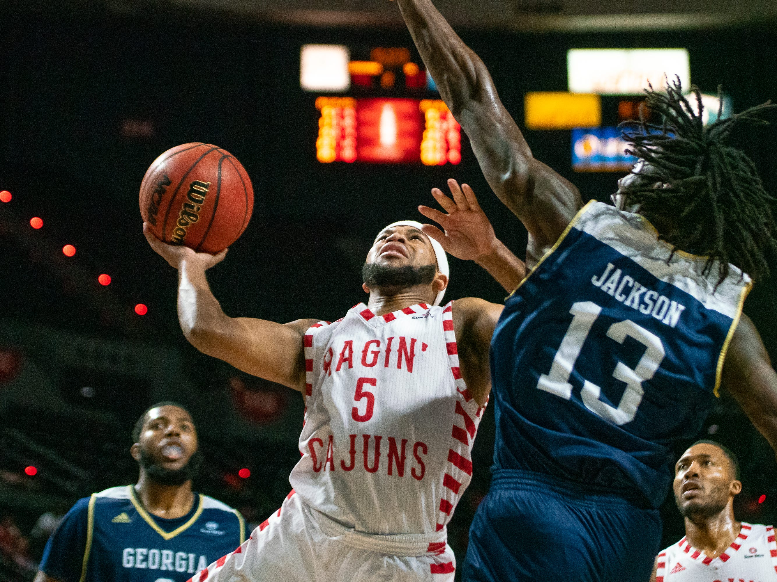UL's Trajan Wesley attempts to score a layup as the Ragin' Cajuns take on the Georgia Southern Eagles at the Cajundome on Feb. 6, 2019.