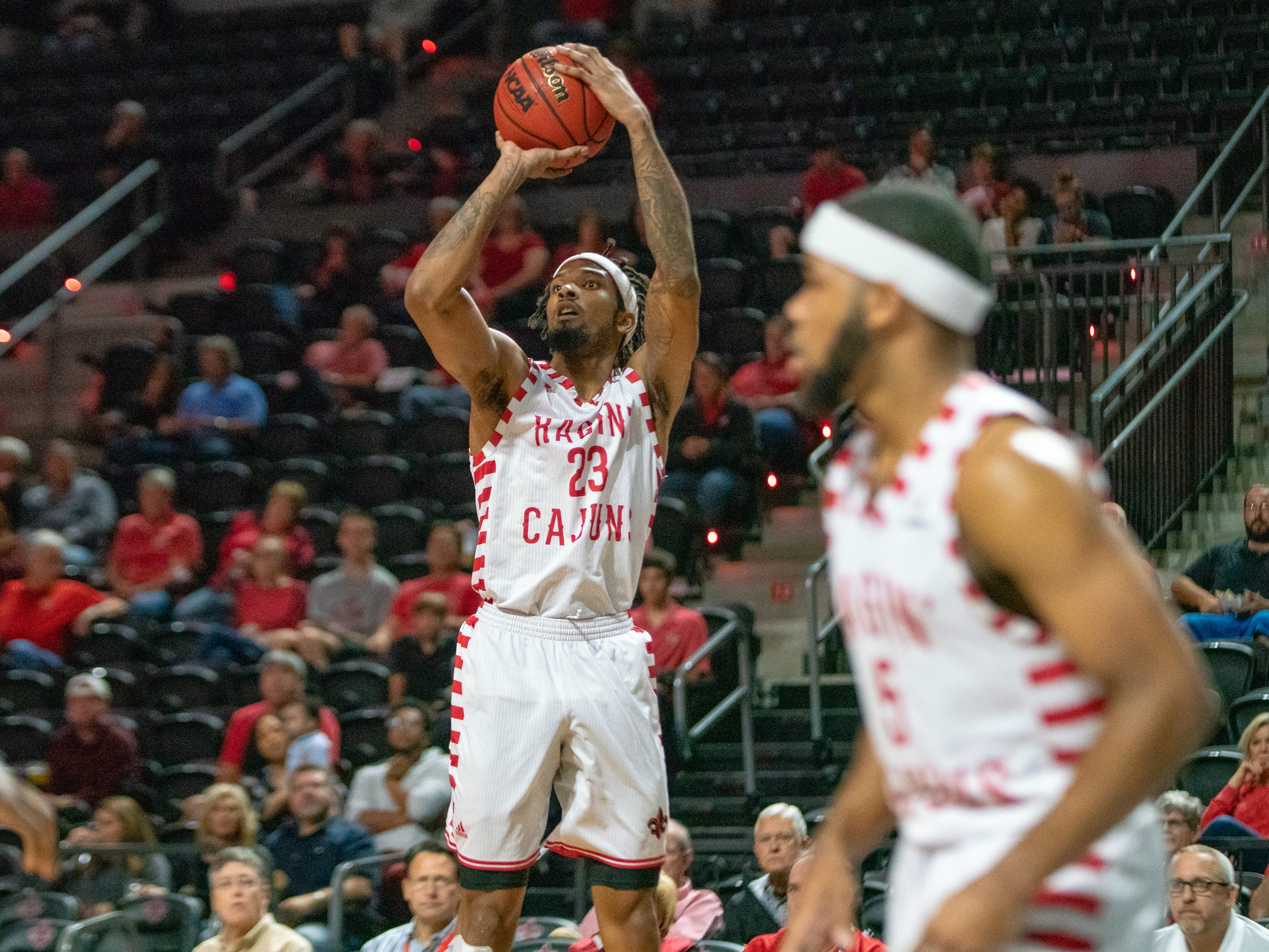 UL's JaKeenan Gant shoots for three points as the Ragin' Cajuns take on the Georgia Southern Eagles at the Cajundome on Feb. 6, 2019.