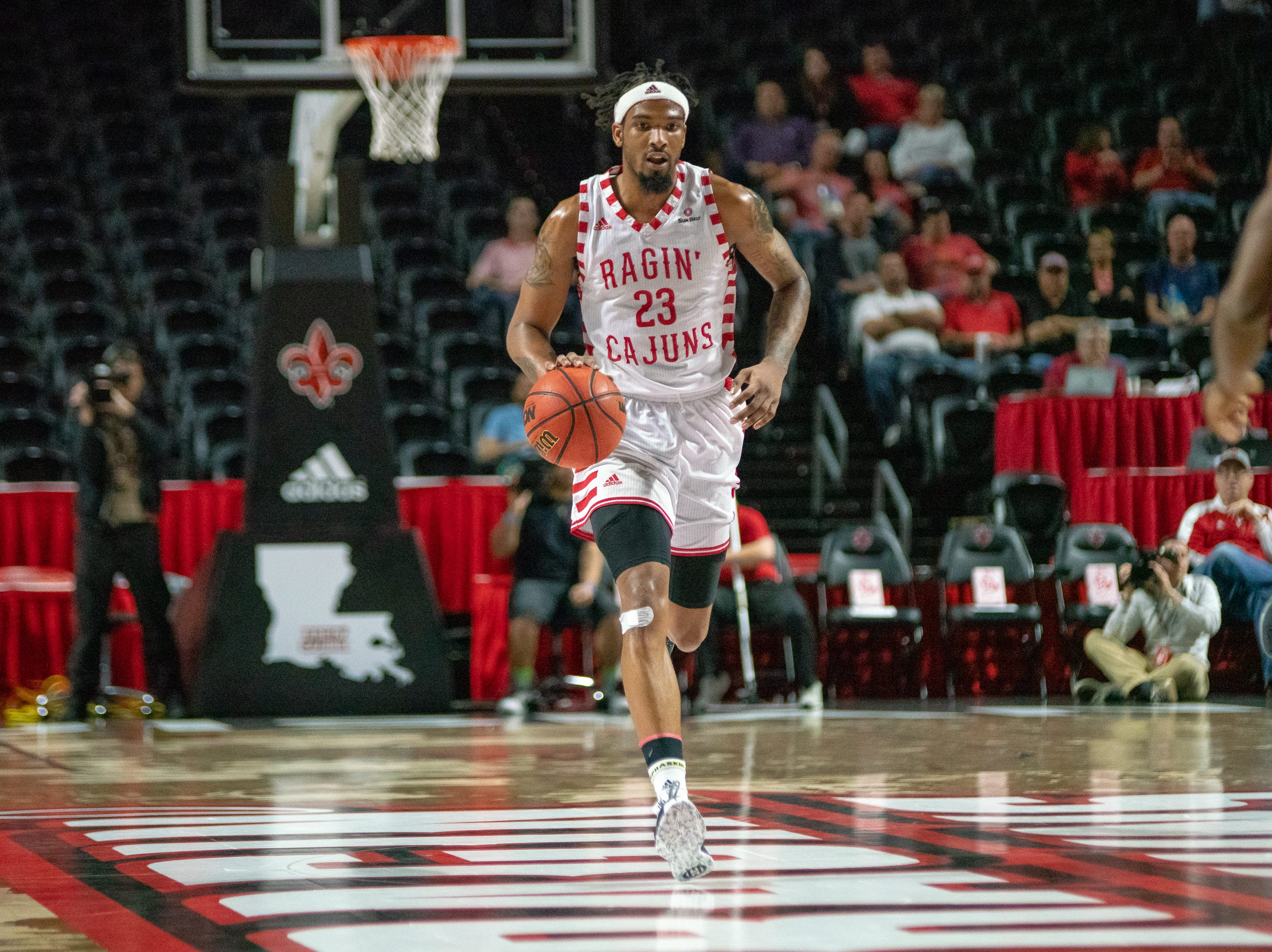 UL's JaKeenan Gant sprints down the court as the Ragin' Cajuns take on the Georgia Southern Eagles at the Cajundome on Feb. 6, 2019.