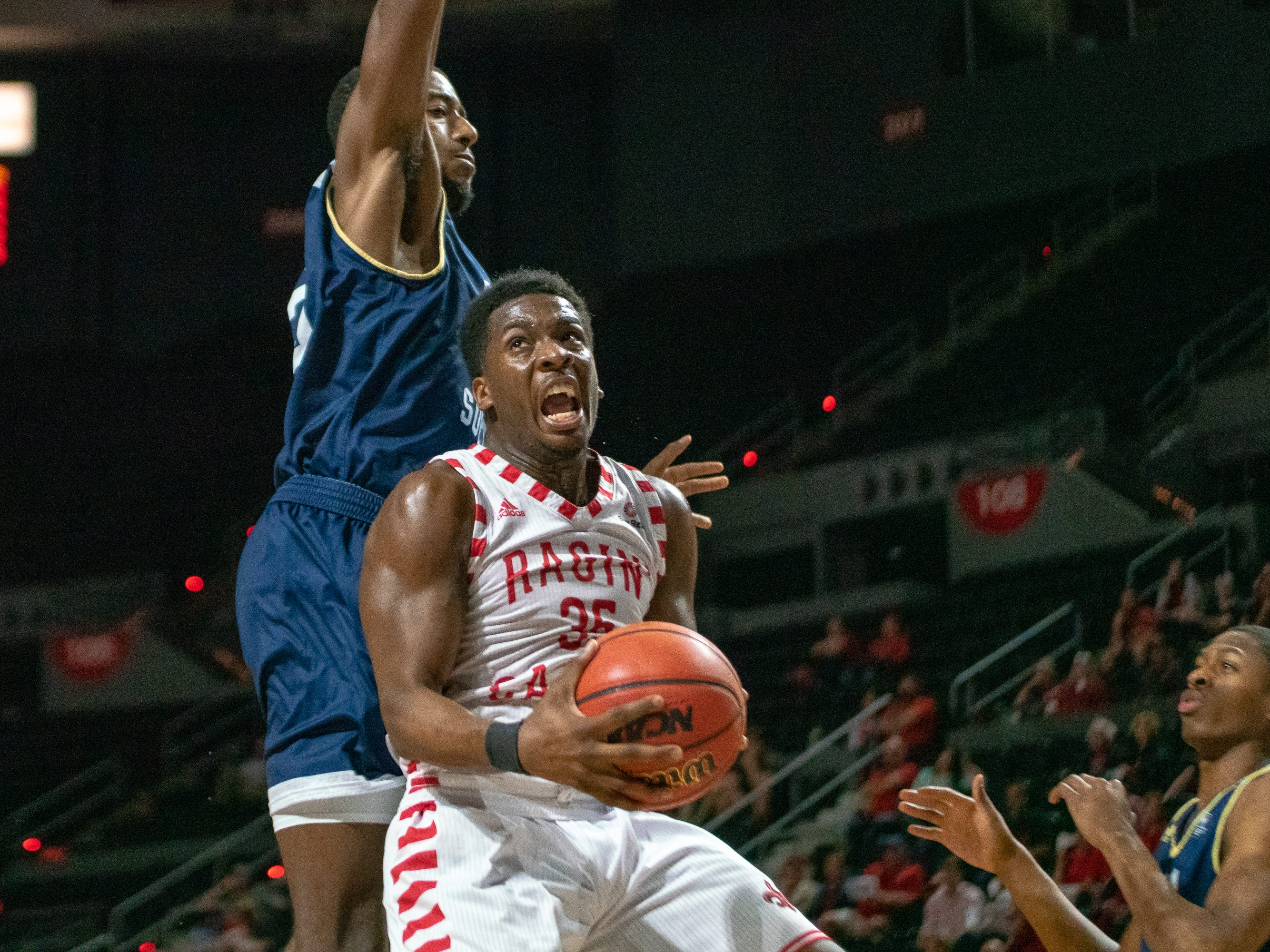 UL's Marcus Stroman attempts a shot from under the goal as the Ragin' Cajuns take on the Georgia Southern Eagles at the Cajundome on Feb. 6, 2019.