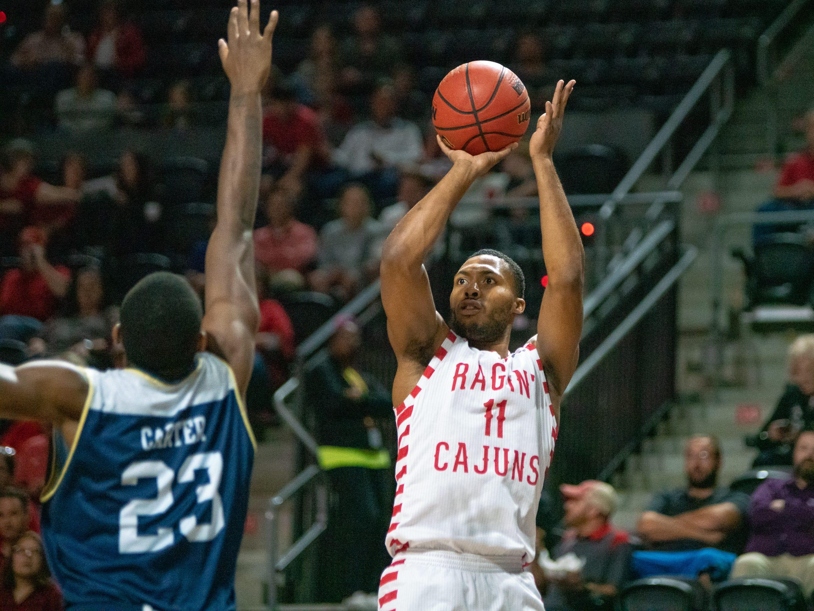 UL's Jerekius Davis shoots the ball to score as the Ragin' Cajuns take on the Georgia Southern Eagles at the Cajundome on Feb. 6, 2019.