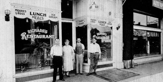 Richards' Restaurant was located at 210 W. Main St. from 1926 until about 1940. This photo was taken about 1937 and includes Albert J. Richards, owner, (far right) and his wife Lillian.