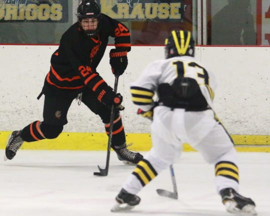 Brighton's Michael Forfinski controls the puck while defended by Hartland's Dakota Kott during the Eagles' 4-0 victory on Wednesday, Feb. 6, 2019.