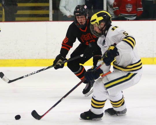 Hartland's Vlad Sarcevich carries the puck while being pursued by Brighton's Will Jentz in the Eagles' 4-0 victory on Wednesday, Feb. 6, 2019.