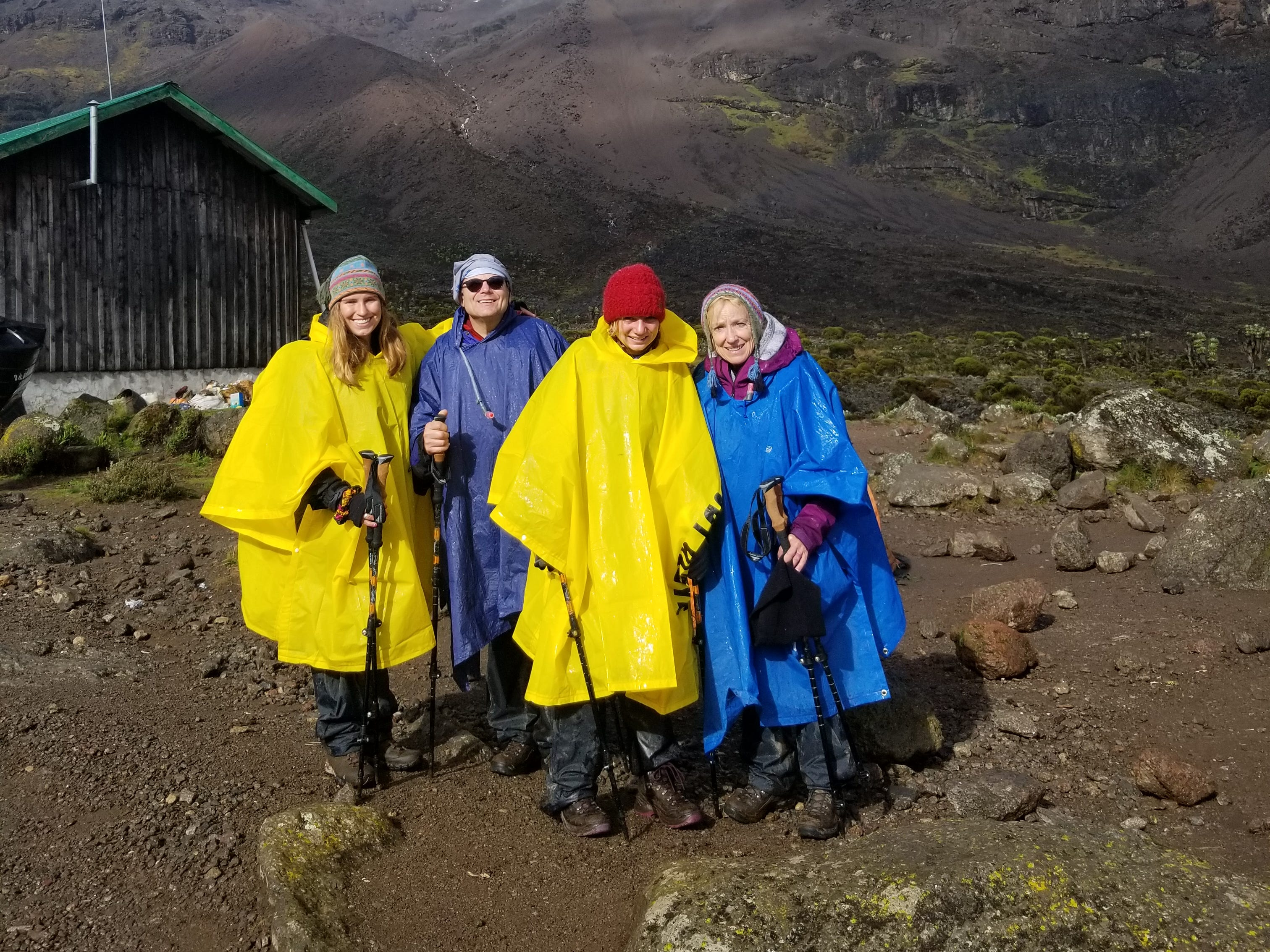 The sun comes out, briefly while Elliott, John and  Jordan Grantz and Kirby Adams-Grantz trek Mount Kilimanjaro