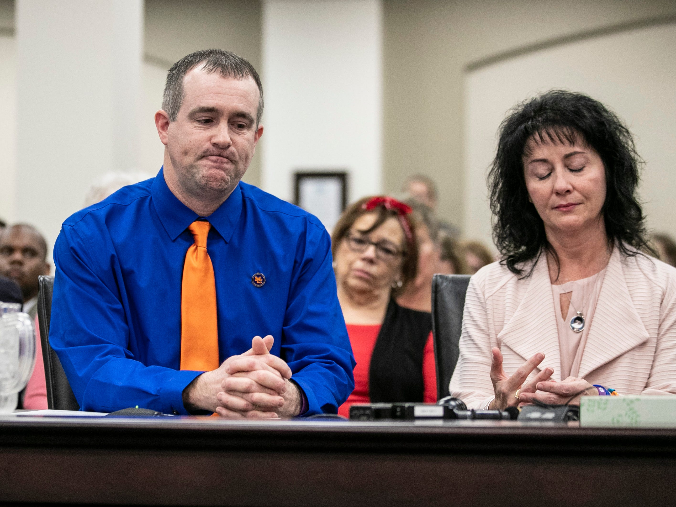 Brian Cope, with wife Theresa beside him, became emotional while speaking before lawmakers Thursday in Frankfort about the need for improved school safety. Their son Preston Cope was shot and killed during the Marshall County High School shooting in 2018. Bailey Holt was also killed. Feb. 7, 2019