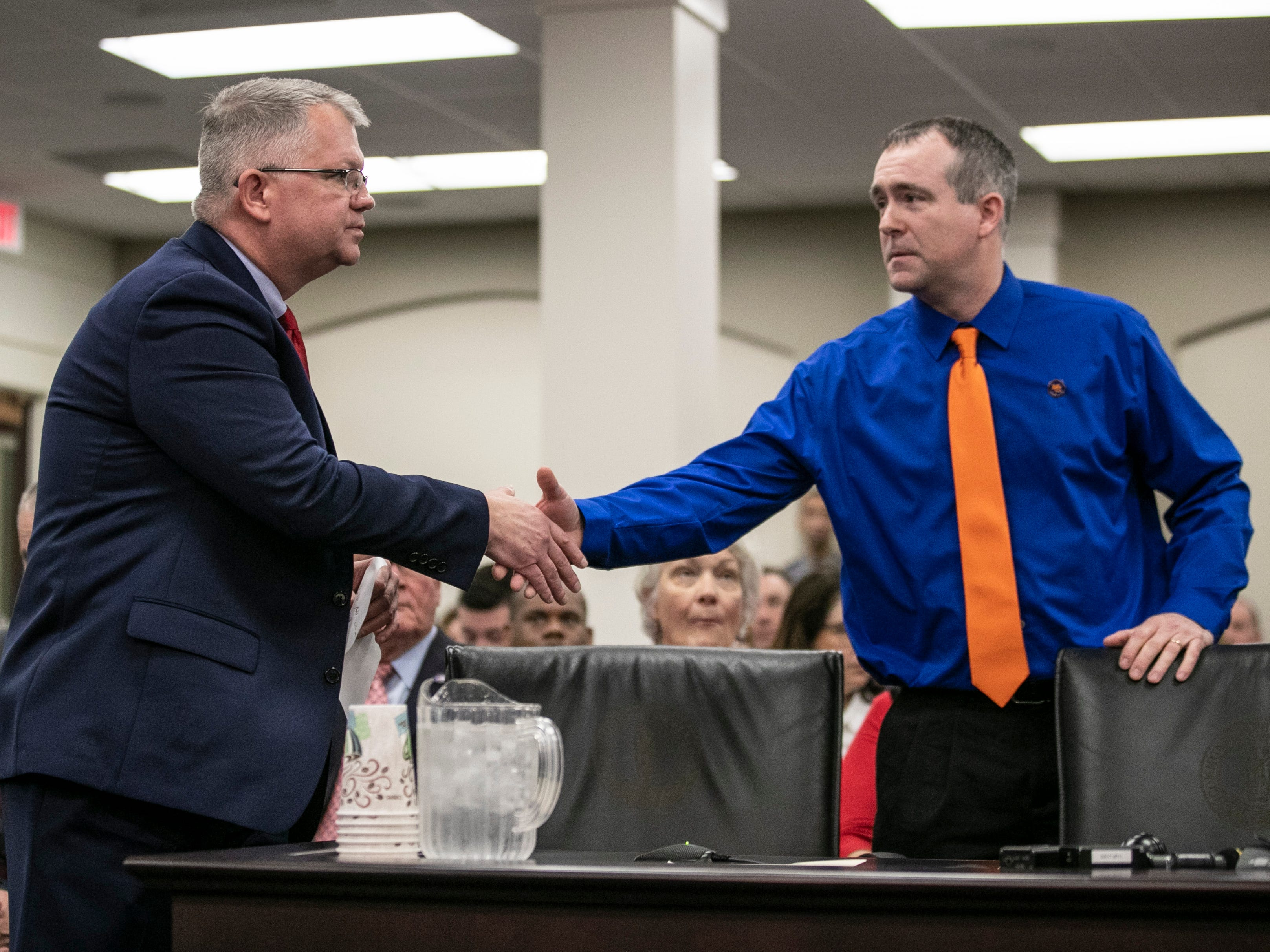 Kentucky Senator Danny Carroll shakes the hand of Brian Cope before a hearing on SB 1 Thursday in Frankfort. Their son Preston Cope was one of two teenagers killed in the Marshall County High School shooting in 2018. Brian Cope would urge lawmakers to pass a school safety bill; his son Preston Cope was one of two teenagers killed during the Marshall County  High School Shooting in 2018.