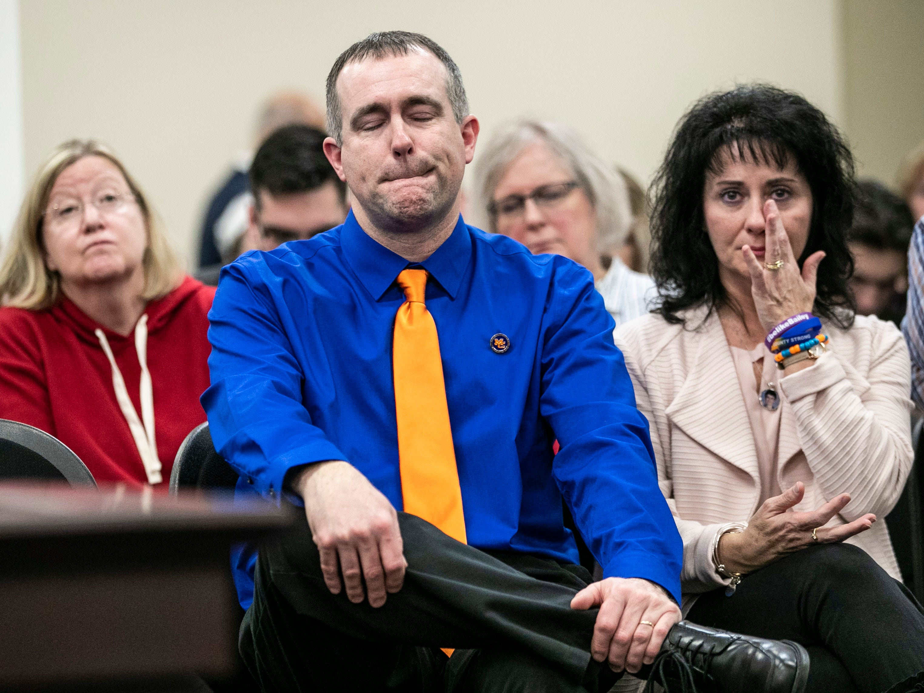 Brian Cope sits next to wife Theresa Cope as they listened during a hearing on SB 1 Thursday in Frankfort. Their son Preston Cope was one of two teenagers killed in the Marshall County High School shooting in 2018.