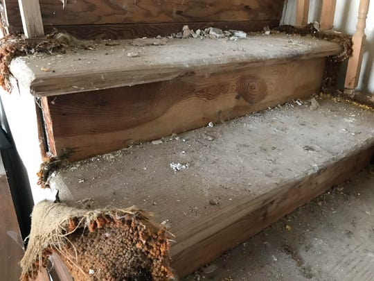 "Stairs leading up to the second floor at an abandoned home on Billwood Highway. Often referred to as ""the Addams Family house,"" new owner Matt Jankoviak aims to remodel it, and then open a canoe and kayaking livery at the property."