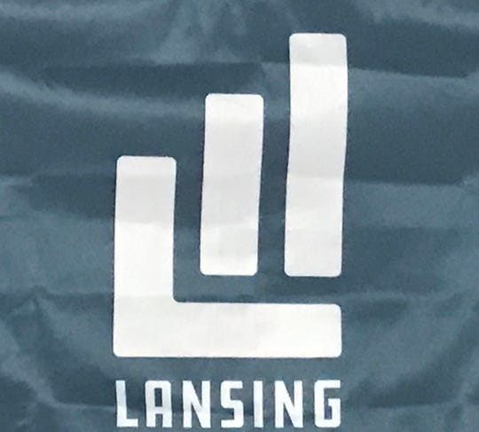 A close-up of a flag on Wednesday, Feb. 6, 2019 shows a logo created by Redhead Design Studio for the city of Lansing.