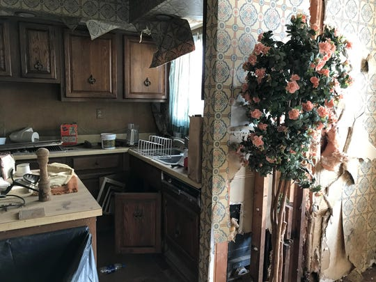 """The kitchen in an abandoned home on Billwood Highway. Often referred to as """"the Addams Family house,"""" new owner Matt Jankoviak aims to remodel it, and then open a canoe and kayaking livery at the property."""