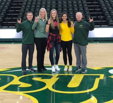 Manitowoc Lutheran senior Emily Behnke, middle, recently verbally committed to play basketball for NCAA Division I North Dakota State University.