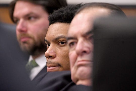 Flanked by his attorneys, Deshawn Dowdell listens to opening statements from the prosecutor Thursday during the first day of his murder trial for the shooting death of 19-year-old Terrence Travon Harris in April of 2018.