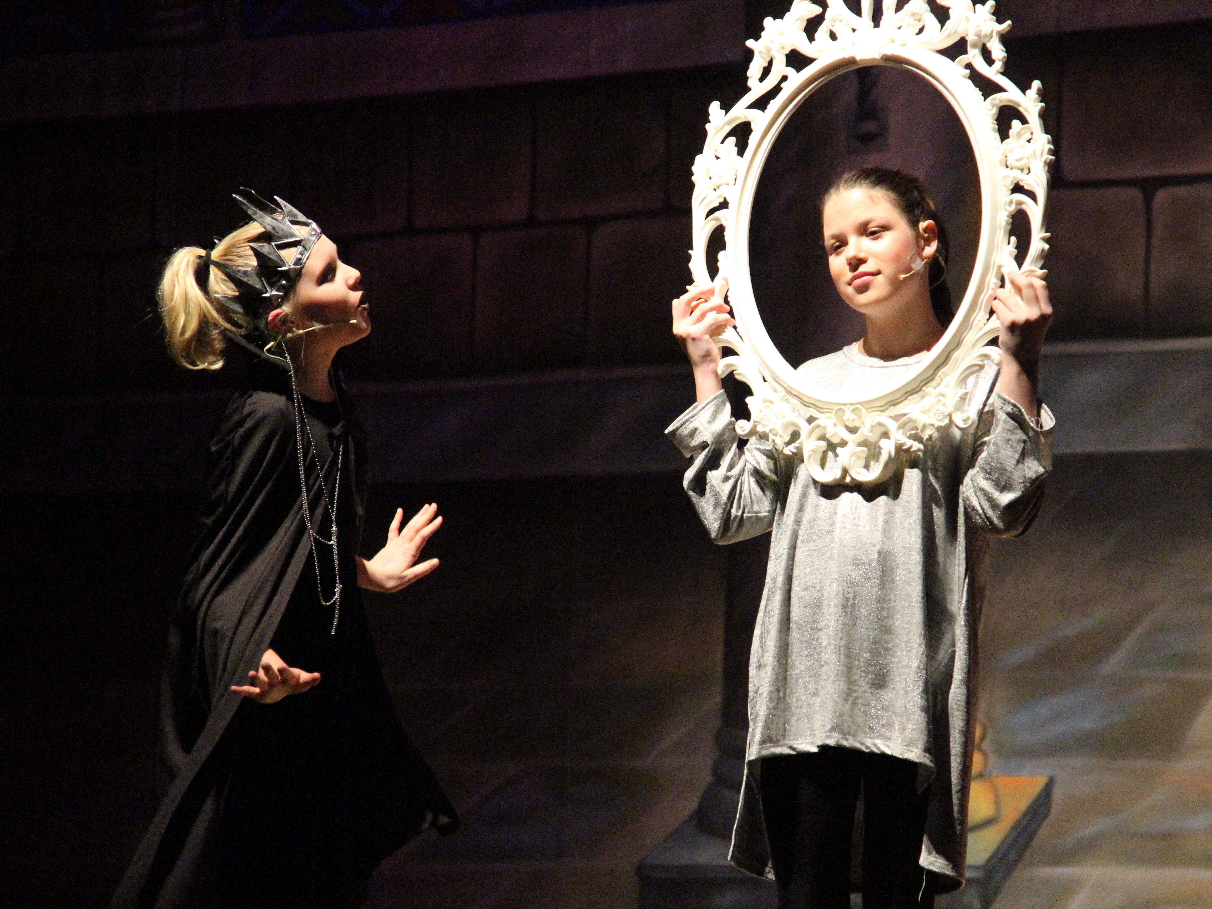 """Julia Pearch, as the evil queen, asks the mirror, played by Emily Hypes, who the fairest in the land is in the Marion Palace Theatre's production of """"The Tale of Snow White,"""" an adaptation of the classic fairy tale. The production starts at 7:30 p.m. Friday and Saturday, Feb. 8 and 9 and at  2 p.m. Sunday, Feb. 10."""