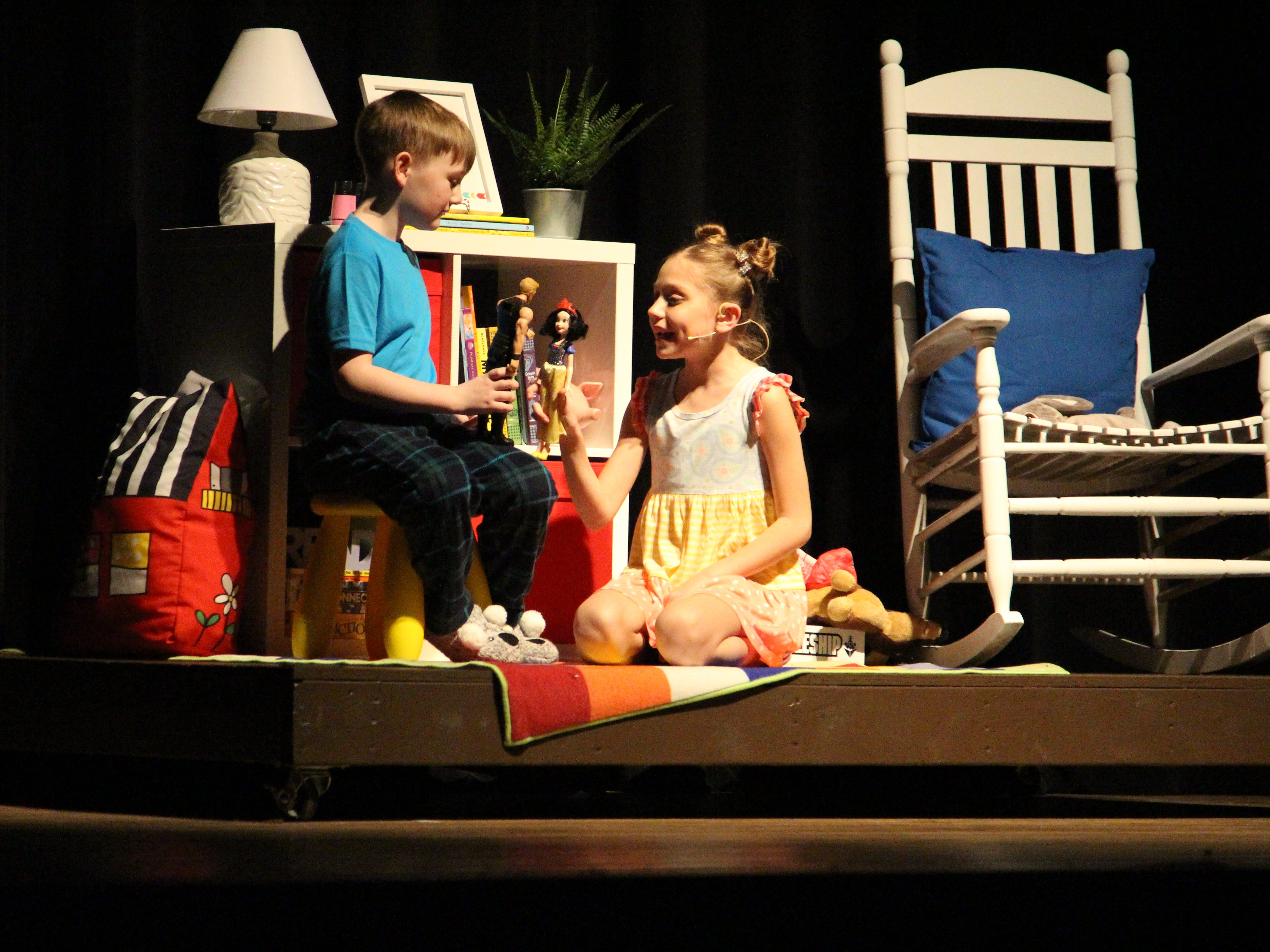 """Austin Hicks and Madelyn Cheney play two children who listen to the story of Snow White in the Marion Palace Theatre's production of """"The Tale of Snow White,"""" an adaptation of the classic fairy tale."""