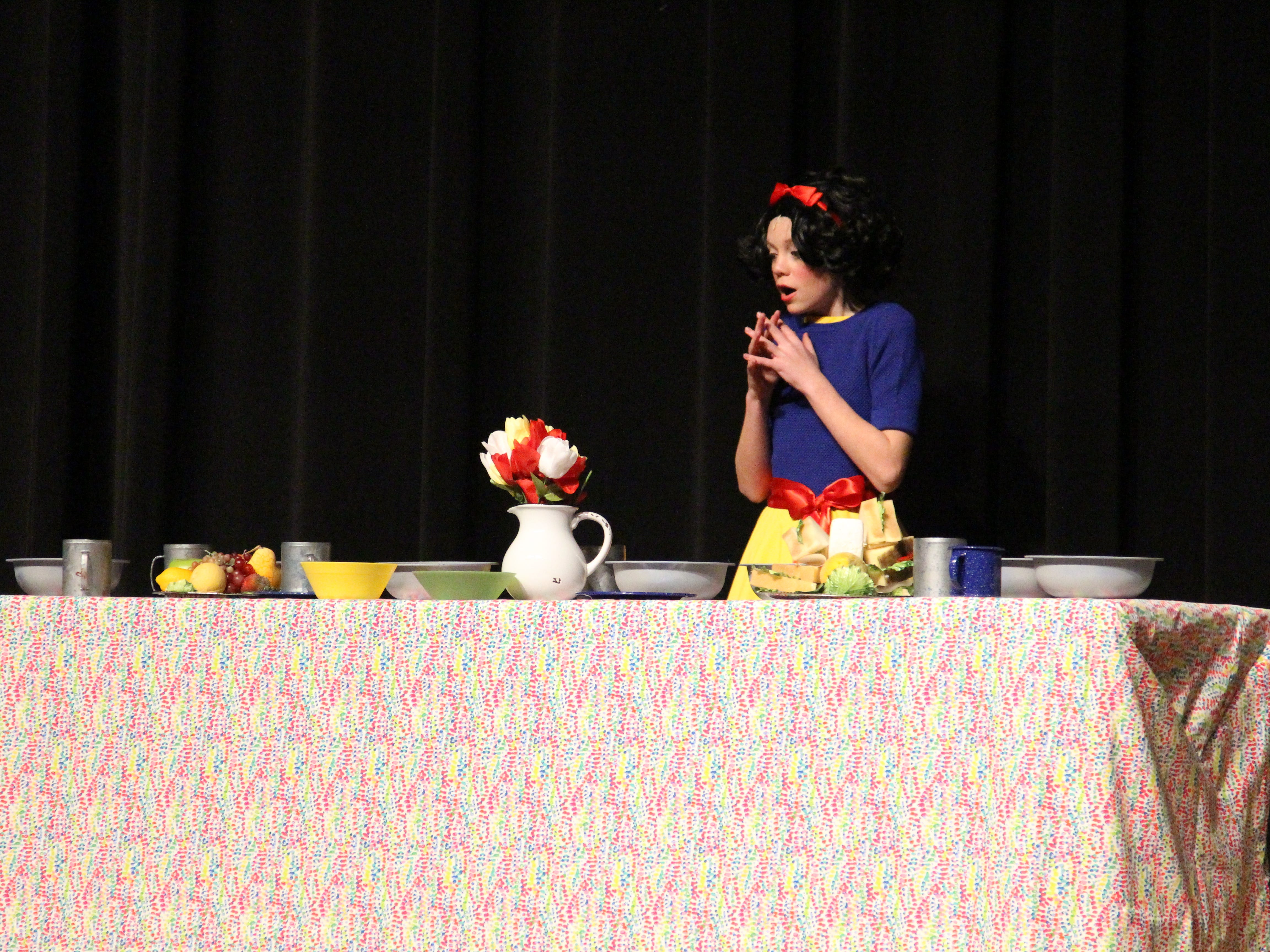 """Snow White, played by Morgan Elliott, stumbles upon the dwarves' abode after finding out that the evil queen wants her dead in the Marion Palace Theatre's production of """"The Tale of Snow White,"""" an adaptation of the classic fairy tale. The production starts at 7:30 p.m. Friday and Saturday, Feb. 8 and 9 and at  2 p.m. Sunday, Feb. 10."""