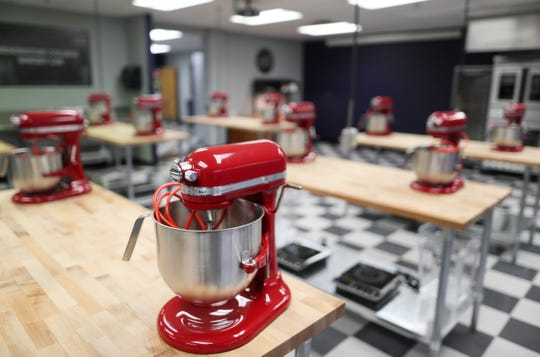 "Mixers line the cutting board tables in the kitchen of a new culinary facility at Remington College where Kathy Wakile, known for her role in ""The Real Housewives of New Jersey,"" has partnered with the school for a culinary degree program."