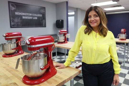 "Kathy Wakile, known for her role in ""The Real Housewives of New Jersey,"" stands in the kitchen of a new culinary facility at Remington College in Memphis. Wakile and the college have teamed up for a culinary degree program."