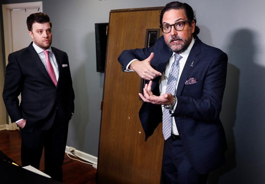 While demonstrating how a gun would be held, attorney Murray Wells, right. and fellow lawyer Aaron Neglia discuss the 2017 shooting death of Ismael Lopez by Southaven police on Thursday, Feb. 7, 2019. During the interview, Wells and Neglia, who are representing the family of Lopez, stated information in a new Mississippi Bureau of Investigation report conflicted with officer's statements.
