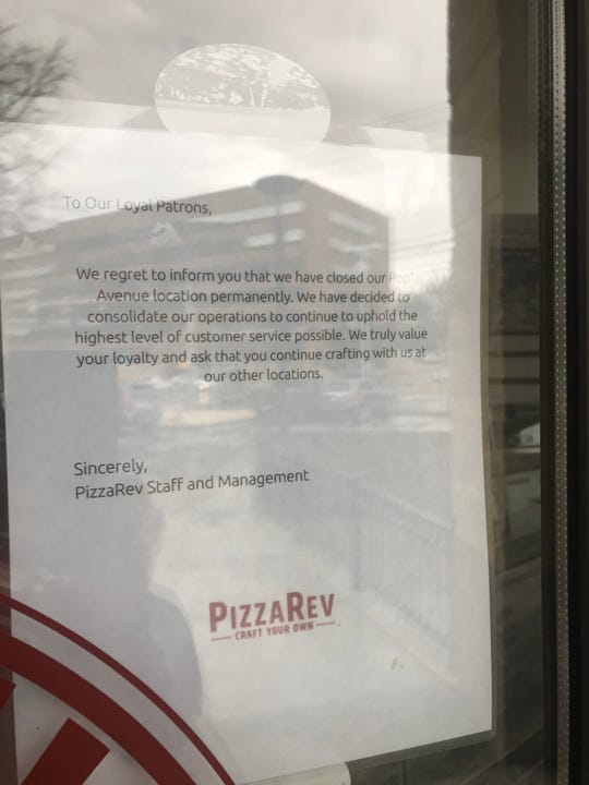 PizzaRev announces the closing of their Poplar Ave. restaurant with a note posted inside the front door. Similar notes were posted on the company's two Cordova locations.