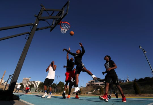 Basketball players hit the court at Tom Lee Park on a warm Sunday afternoon Feb. 3, 2019.