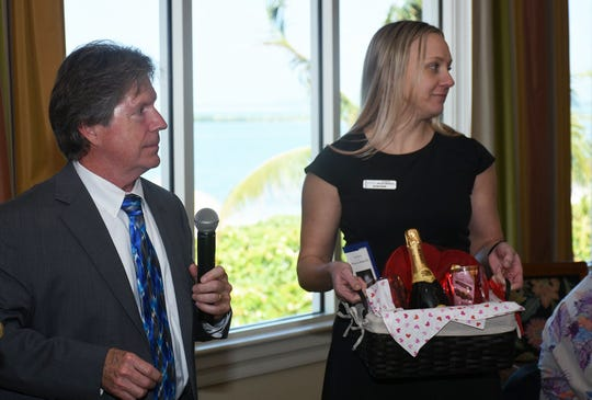 Meeting sponsor and island attorney Bill Morris, and Sarah Smith hand out a door prize. The Marco Island Area Association of Realtors' general membership lunch at the Hideaway Beach Club on February 5 featured remarks from Interim City Manager David Harden and City Council Chairman Erik Brechnitz.
