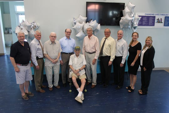 Former board presidents line up with CEO Cindy Love-Abounader, far right. From left, Skip Merriam, Tom Wagor, Jim Curran, Pat Neale, Mel Ollman, Ernie Bretzmann, Craig Woodward, Marv Needles and Ashley Lupo.