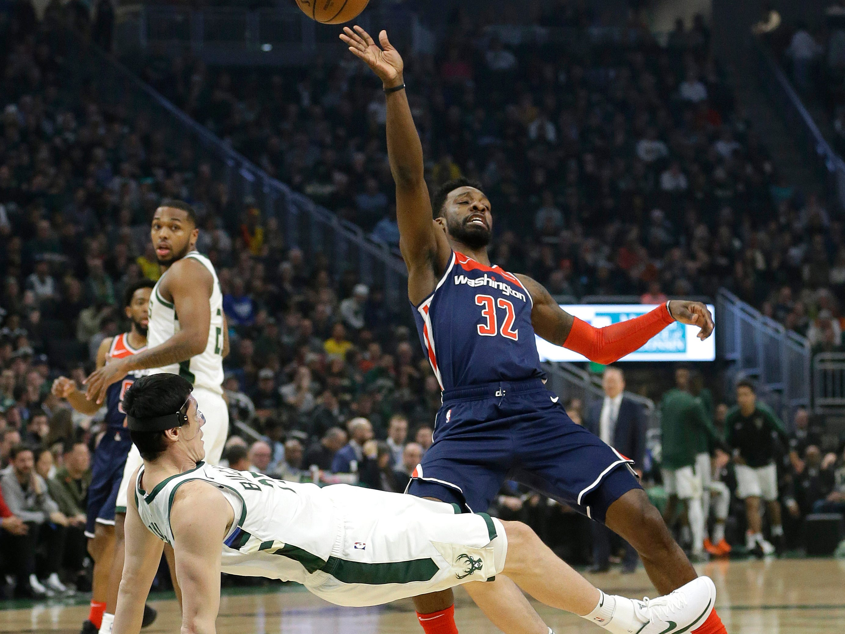 Bucks forward Ersan Ilyasova draws a charging foul on Wizards forward Jeff Green during the first half Wednesday night.