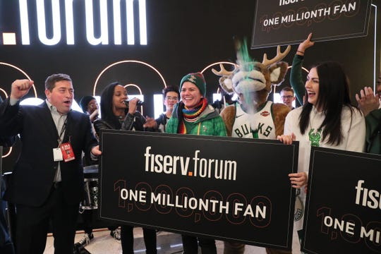 The Bucks recognize their 1 millionth customer to attend an event at Fiserv Forum since the arena opened in August on Wednesday. Here, Samantha Holschuh of St. Francis is greeted by Bucks President Peter Feigin, Bango and other members of the Bucks and arena team. She received a gift package for the honor.