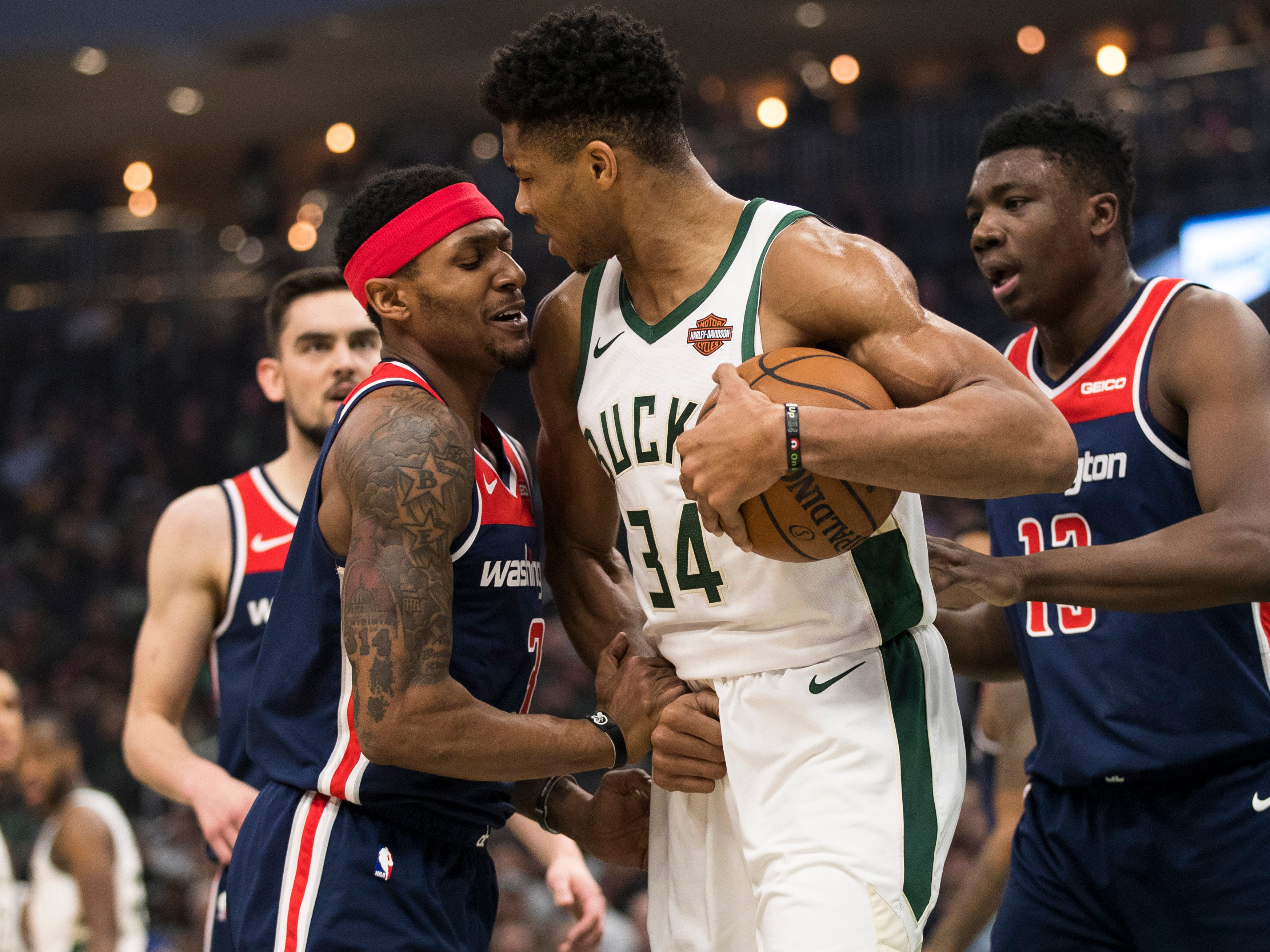 Bucks forward Giannis Antetokounmpo and Wizards guard Bradley Beal get into it a little bit during the first quarter on Wednesday night.