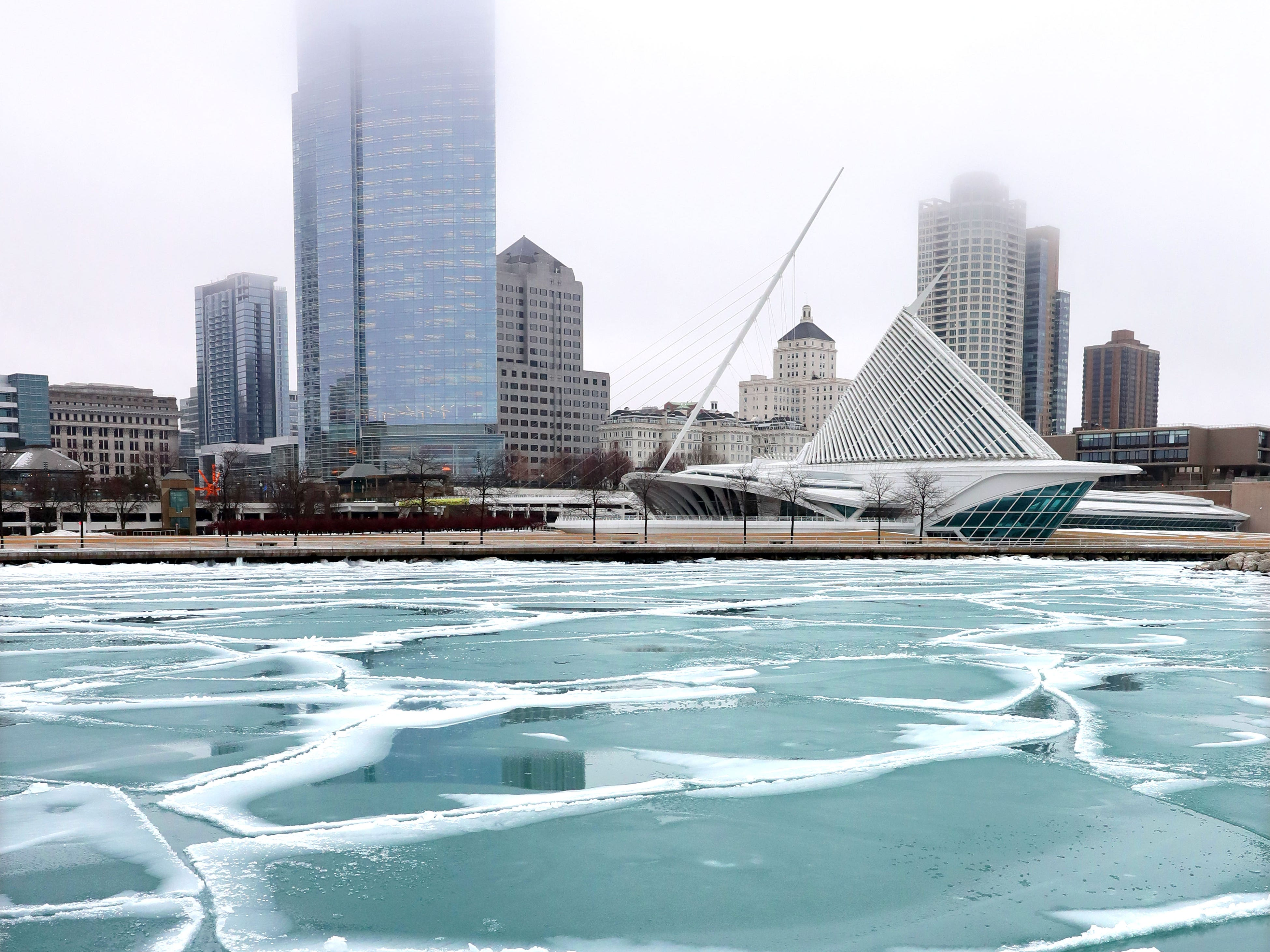 Chunks of ice float in the Lake Michigan bay area near the Milwaukee Art Museum in Milwaukee on Wednesday, Feb. 6, 2019. While freezing rain made roads and sidewalks a slushy mess Wednesday, the Milwaukee metro area is in for another round of icy weather that is expected to make the commutes hazardous Wednesday night and Thursday morning. A winter weather advisory for Ozaukee and Washington counties as well as the Madison area has been issued for 6 p.m. Wednesday to 6 p.m Thursday. Total snow accumulations of up to 2 inches and ice accumulations of two-tenths to three-tenths of an inch are expected.