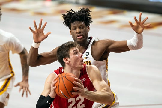 Badgers forward Ethan Happ works against Gophers center Daniel Oturu during the second half Wednesday night. Happ paced UW once again with a 15-point, 13-rebound effort.