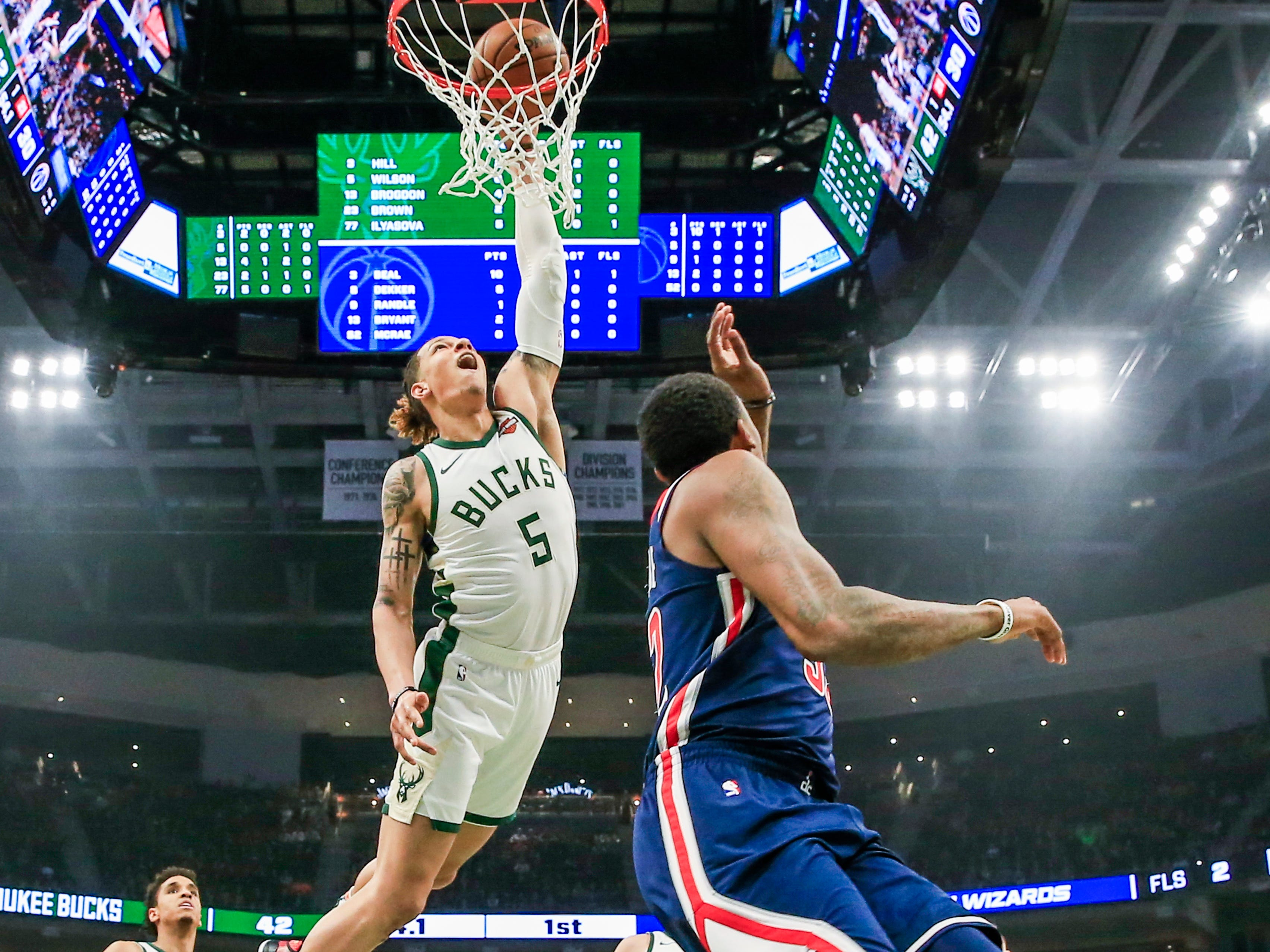 Bucks forward DJ Wilson finishes a fast break with a dunk against the Wizards during the first quarter on Wednesday night.