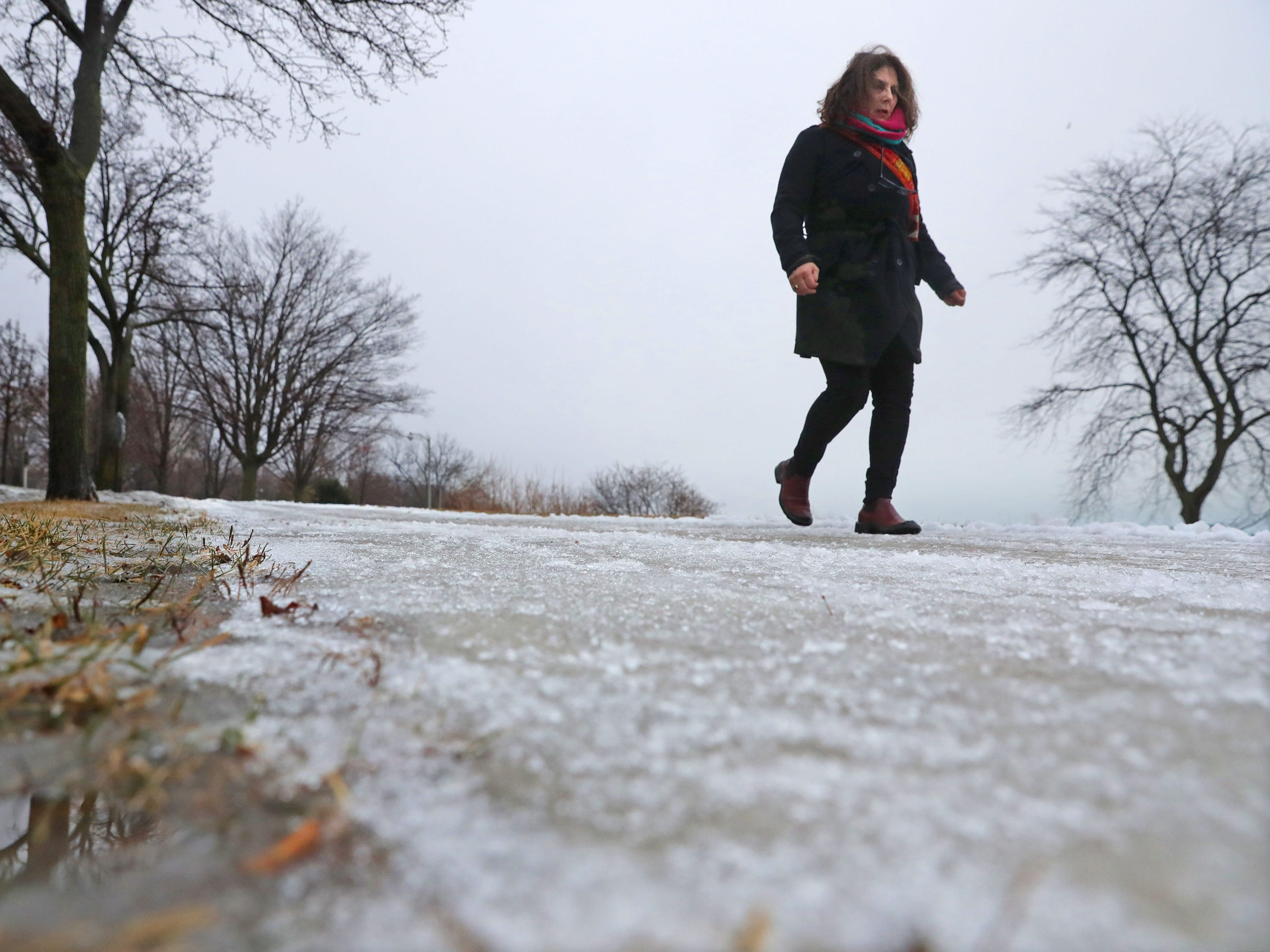Dianna Sjoberg, of Milwaukee, watches her footing as she walks along an icy sidewalk on North prospect Avenue in Milwaukee on Wednesday, Feb. 6, 2019. While freezing rain made roads and sidewalks a slushy mess Wednesday, the Milwaukee metro area is in for another round of icy weather that is expected to make the commutes hazardous Wednesday night and Thursday morning. A winter weather advisory for Ozaukee and Washington counties as well as the Madison area has been issued for 6 p.m. Wednesday to 6 p.m Thursday. Total snow accumulations of up to 2 inches and ice accumulations of two-tenths to three-tenths of an inch are expected.