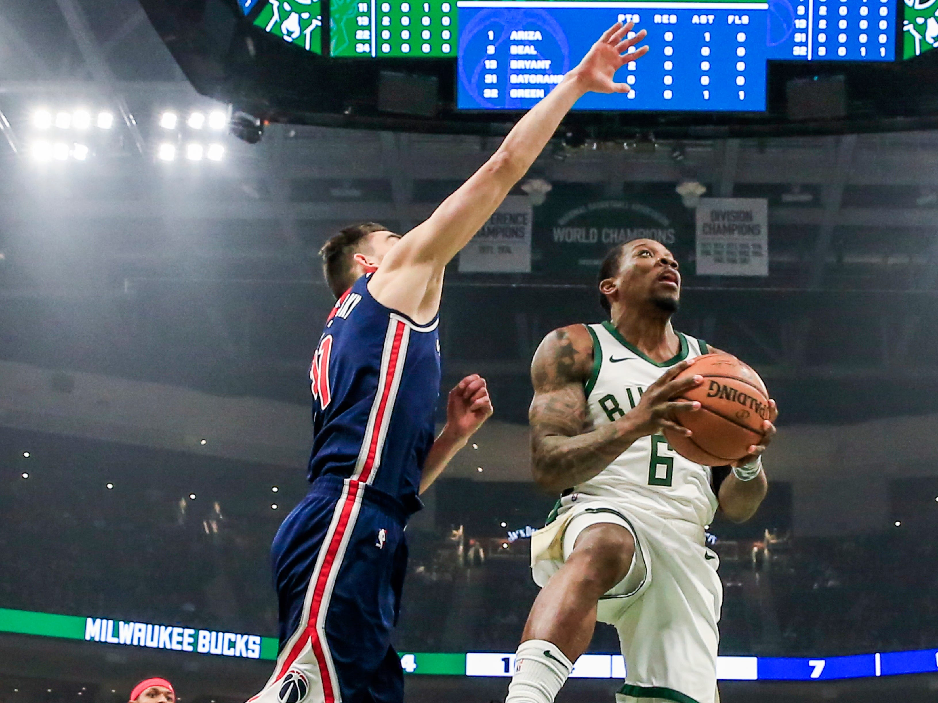 Bucks guard Eric Bledsoe gets under the outstretched arm of the Wizards' Tomas Satoransky as he goes in for a shot down low during the first half Wednesday.