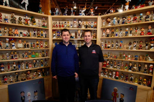 National Bobblehead Hall of Fame and Museum founders Brad Novak (left)  and Phil Sklar are surrounded by their exhibits in January at  the National Bobblehead Hall of Fame and Museum in Milwaukee.