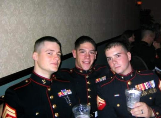Ryan Lackey, Matthew Rittner (center) and Greg Paterson at the Marine Ball in 2008 or 2009.