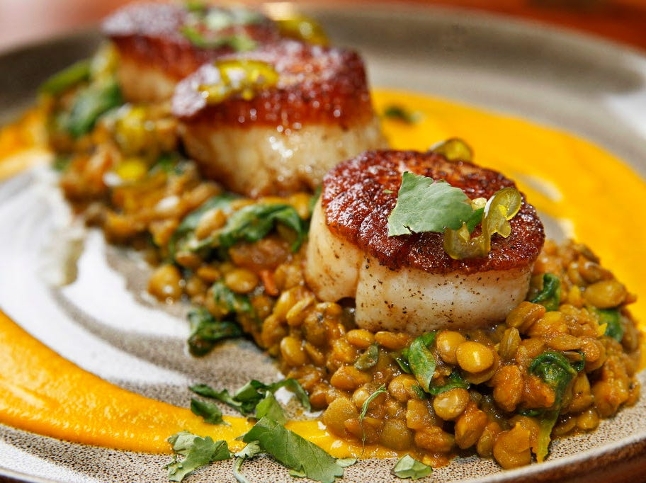 Seared sea scallops over lentils seasoned with Moroccan spices were a seafood special at Twisted Fire restaurant in Oconomowoc, 515 E. Wisconsin Ave. It's also served with a puree of carrot, coconut and ginger.