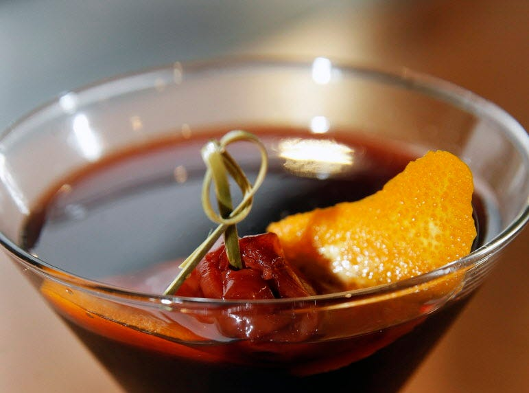 From the Twisted Fire bar: the Inception Manhattan, made with Central Standard  bourbon finished in a Cabernet barrel, Cooper & Thief bourbon-barrel-aged red wine blend, BroVo vermouth, Fee Brothers whiskey barrel bitters, and garnished with an orange twist and brandy soaked cherry.
