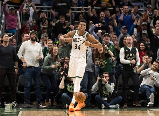 Bucks forward Giannis Antetokounmpo is pumped up, as are the fans, after he threw down a vicious dunk to cap a fast break while being fouled in the process against the Wizards on Wednesday night at Fiserv Forum.