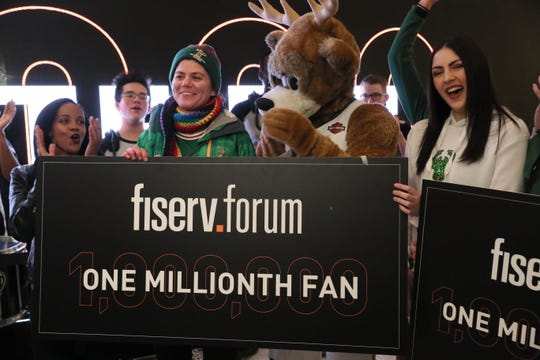 The Bucks recognize their 1 millionth customer to attend an event at Fiserv Forum since the arena opened in August.  Here, Samantha Holschuh of St. Francis is greeted by Bango and other members of the Bucks and arena team.