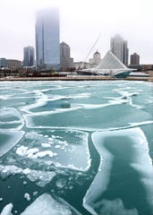 Chunks of ice float in the Lake Michigan bay area near the Milwaukee Art Museum in Milwaukee on Feb. 6, 2019.