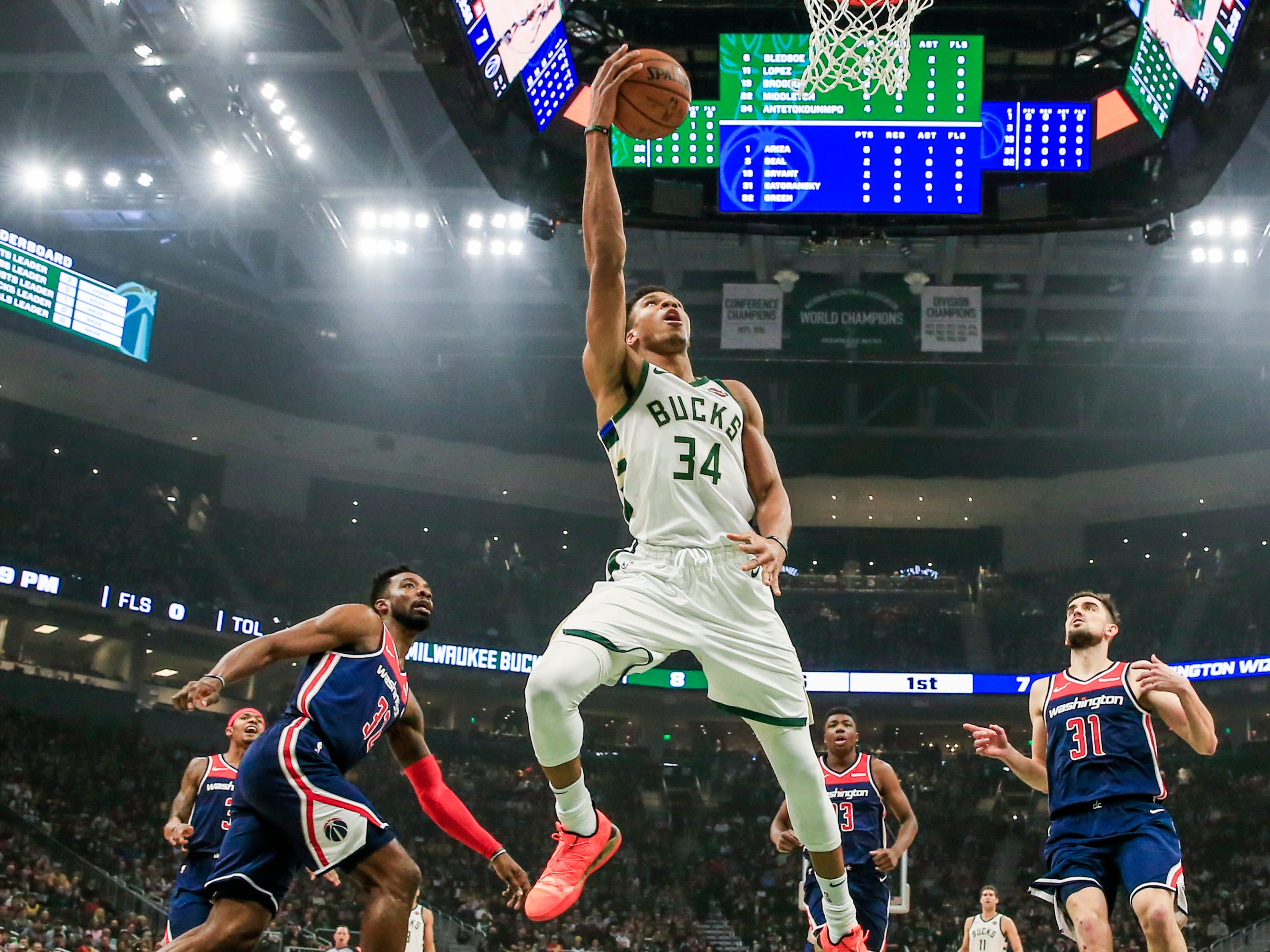 Bucks forward Giannis Antetokounmpo leaves the Wizards' defense in chase mode as he goes up for an easy basket during the first half on Wednesday.