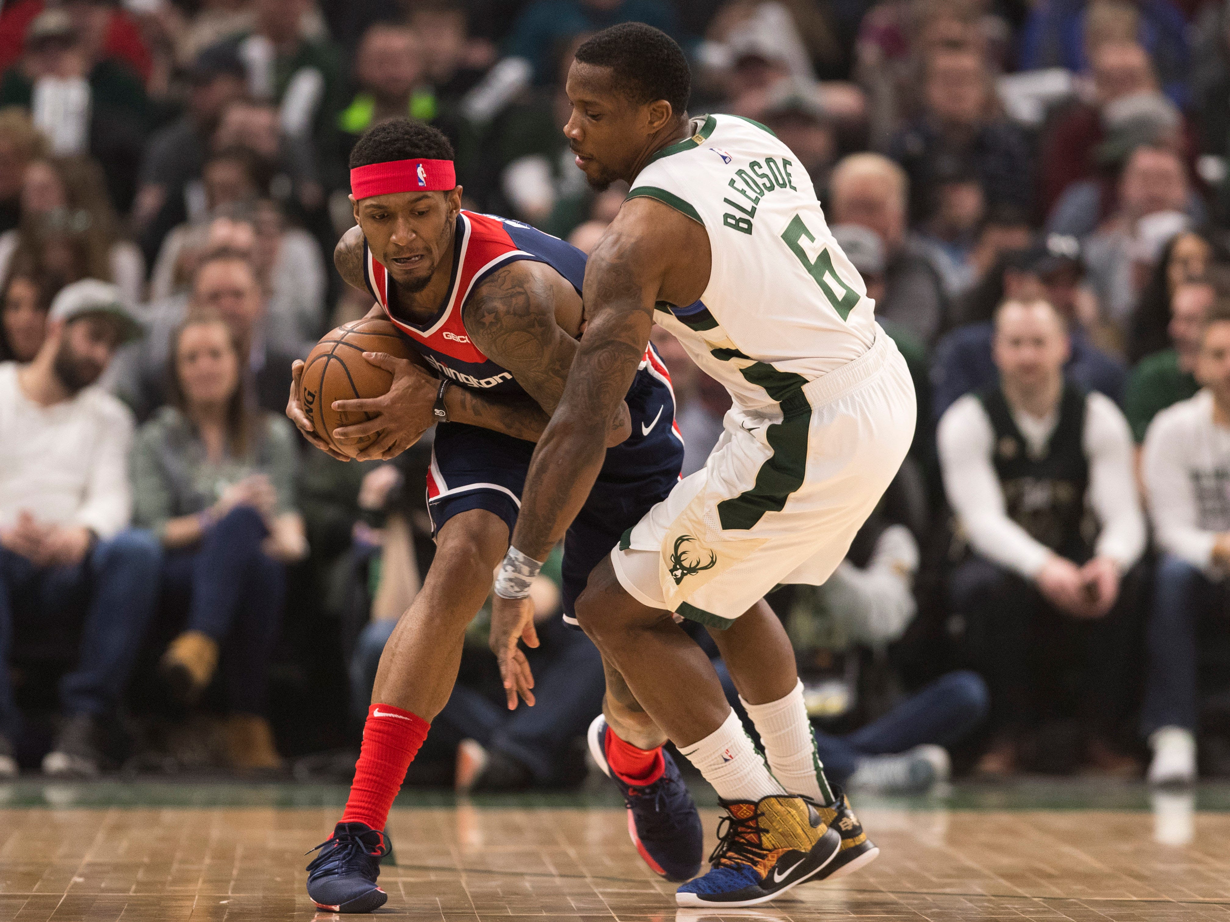 Bucks guard Eric Bledsoe pressures Wizards guard Bradley Beal during the first quarter Wednesday night.