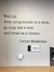 Visitors to the Dwight Foster Public Library in Fort Atkinson see poet Lorine Niedecker's words on the wall. Niedecker worked two different stints for her hometown library.