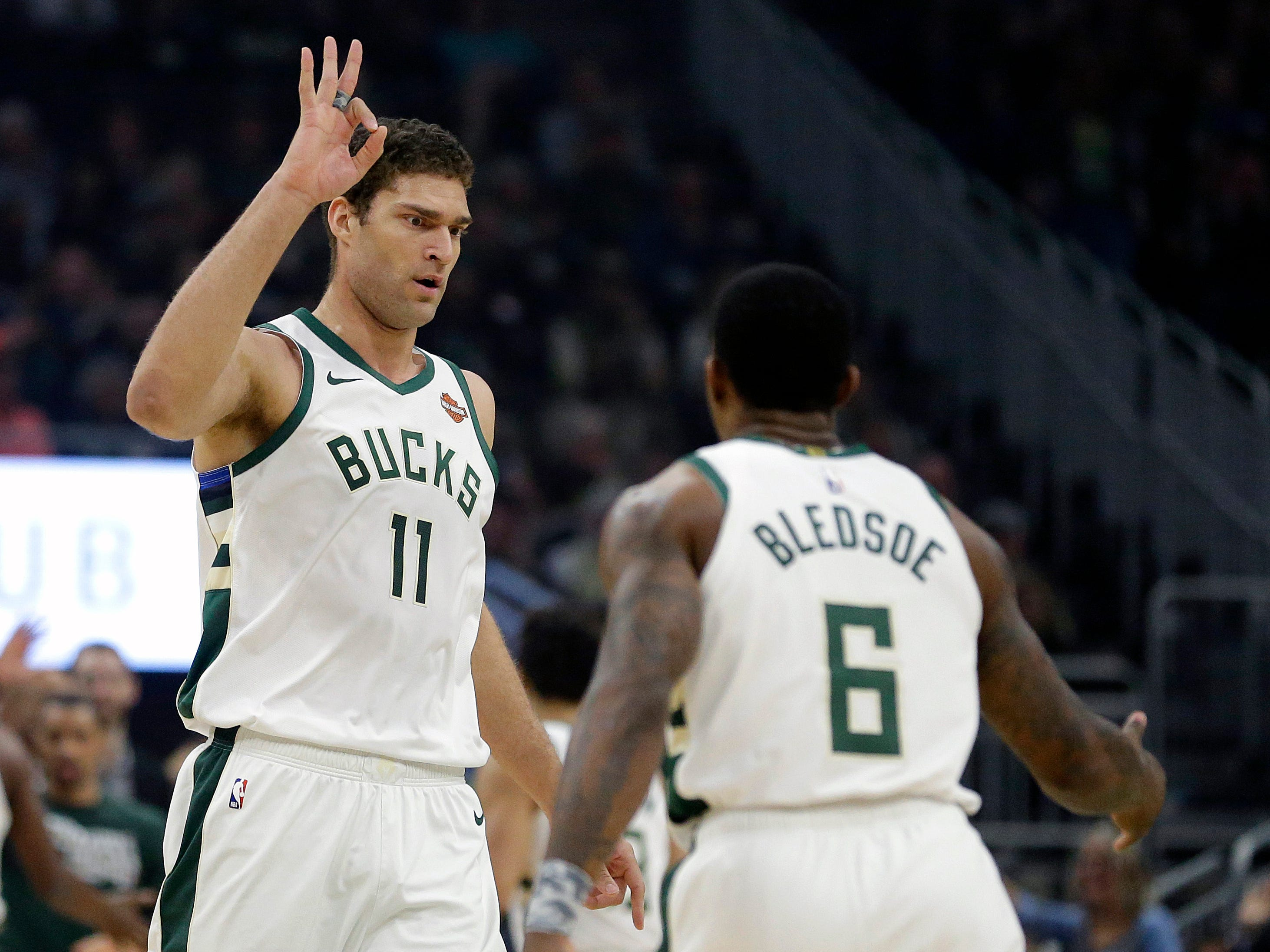 Bucks center Brook Lopez holds up three fingers after hitting his lone three-pointer of the night against the Wizards on Wednesday.